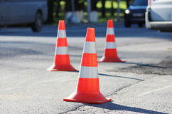 plastic signaling traffic cone encloses a place in the parking lot for trucks Royalty Free Stock Image