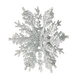 Plastic silver color snowflake Royalty Free Stock Photos