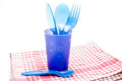 Plastic silverware in the mug Royalty Free Stock Photos