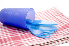 Plastic silverware in the mug Stock Images