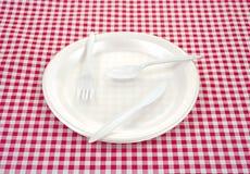 Plastic silverware on plate Royalty Free Stock Photos