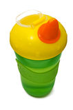 Plastic sippy cup, green with yellow cover Royalty Free Stock Photography