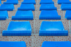 Plastic sits. Rows of blue plastic swimming pool sits.Shallow DOF Royalty Free Stock Photos