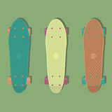 3 plastic skateboards, known within the industry as a short cruiser. Vector illustration with 3 plastic skateboards, known within the industry as a short cruiser Stock Images