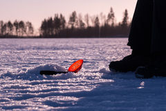 Plastic skimmer scoop laying on ice while ice fishing Stock Image