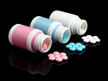 Plastic small bottles with pills. Stock Photo