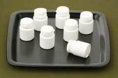 Plastic small bottles on a tray Royalty Free Stock Photography