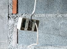 Plastic socket with the electrical wire. Royalty Free Stock Photography