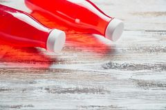 Plastic soda bottle berry juice drink on wooden background. a couple of gallons of refreshing berry drink. the view from stock photos