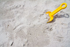 Plastic spade on beach Royalty Free Stock Image