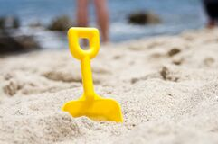 Plastic spade on the beach Royalty Free Stock Photography