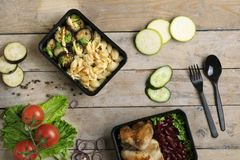 Plastic spoon and fork to eat lunch in box, food containers royalty free stock photo