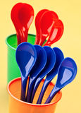 Plastic spoons and cups Stock Images