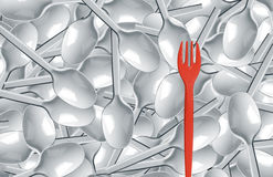 Plastic spoons and red fork. Many white plastic spoons and one red fork Royalty Free Stock Photos