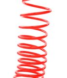 Plastic spring isolated on a white background Stock Images
