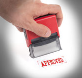 Plastic stamp in hand, isolated Stock Photos