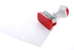 Plastic stamp over white paper Stock Photography