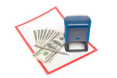 Plastic stamp, US dollars and metal pen over white paper Stock Photos