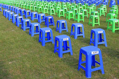 Plastic stools in the square in a park Stock Photography