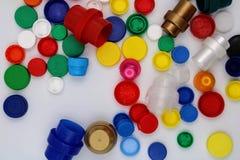 Plastic stoppen van diverse kleuren stock afbeeldingen