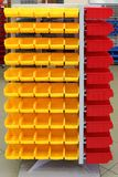 Plastic storage bins. Storage organizer cart with plastic sorting bins stock photos