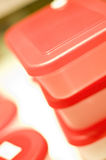 Plastic storage boxes. A stack of plastic storage boxes with red lids Royalty Free Stock Image