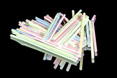 Plastic straws in disarray on a table Royalty Free Stock Images
