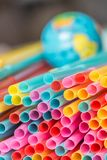 Plastic straws and earth globe, world pollution concept royalty free stock image