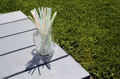 Colored plastic straws in glass jar Stock Image