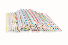 Plastic straws. Lots of plastic drinking straws on a white background Stock Images