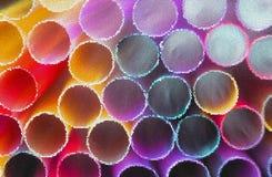 Plastic Straws. Neon Light. Mosaic Effect royalty free stock photo