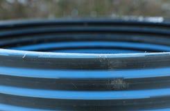 Plastic striped pipe repair manhole ring Royalty Free Stock Photo
