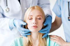 Plastic surgeon or doctor with patient Stock Photo