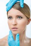 Plastic surgeon examining woman royalty free stock photo