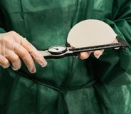 Plastic surgeon hands measuring silicon breast Royalty Free Stock Images