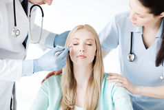 Plastic surgeon and nurse with patient Stock Image