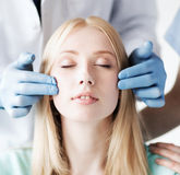 Plastic surgeon and nurse with patient Stock Images