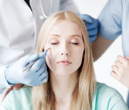 Plastic surgeon and nurse with patient Stock Photo