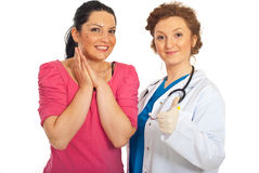 Plastic surgeon with patient gives thumbs Royalty Free Stock Photography