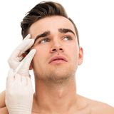 Plastic surgery. Attractive, handsome man Royalty Free Stock Photography