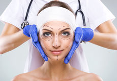 Plastic surgery - Beautiful woman face, with surgical markings Royalty Free Stock Image
