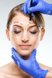 Plastic surgery - Beautiful woman face, with surgical markings Royalty Free Stock Photography