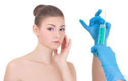 Plastic surgery concept - doctor or beautitian hands with syring Royalty Free Stock Image