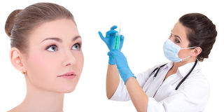 Plastic surgery concept - doctor or beautitian with syringe and Stock Image