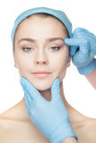 Plastic surgery concept. Doctor hands in gloves touching woman face Royalty Free Stock Photo