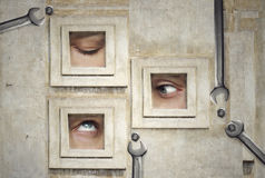 Plastic surgery. Funny and artistic composition of three human eyes Stock Images