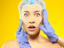 Plastic  surgery.  Isolated on yellow. studio Royalty Free Stock Images