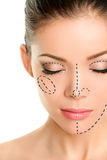 Plastic Surgery Lines On Asian Woman Face Royalty Free Stock Image