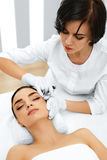 Plastic Surgery. Woman Gets Cosmetic Injection. Cosmetology. Bea Royalty Free Stock Photography