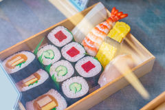 .Plastic Sushi rolls in a display case Stock Images